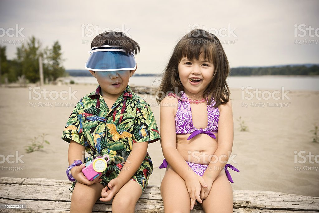Adorable Little Girl and Boy Kids in Beach Swimsuits, Copyspace royalty-free stock photo