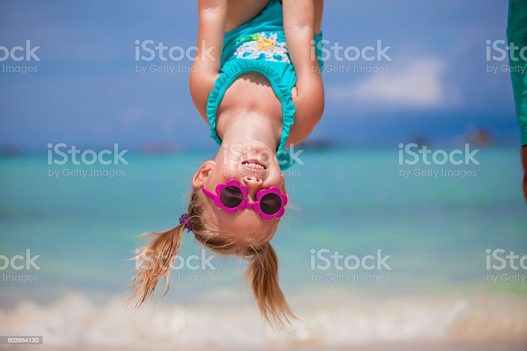 Adorable little girl during beach vacation having fun stock photo