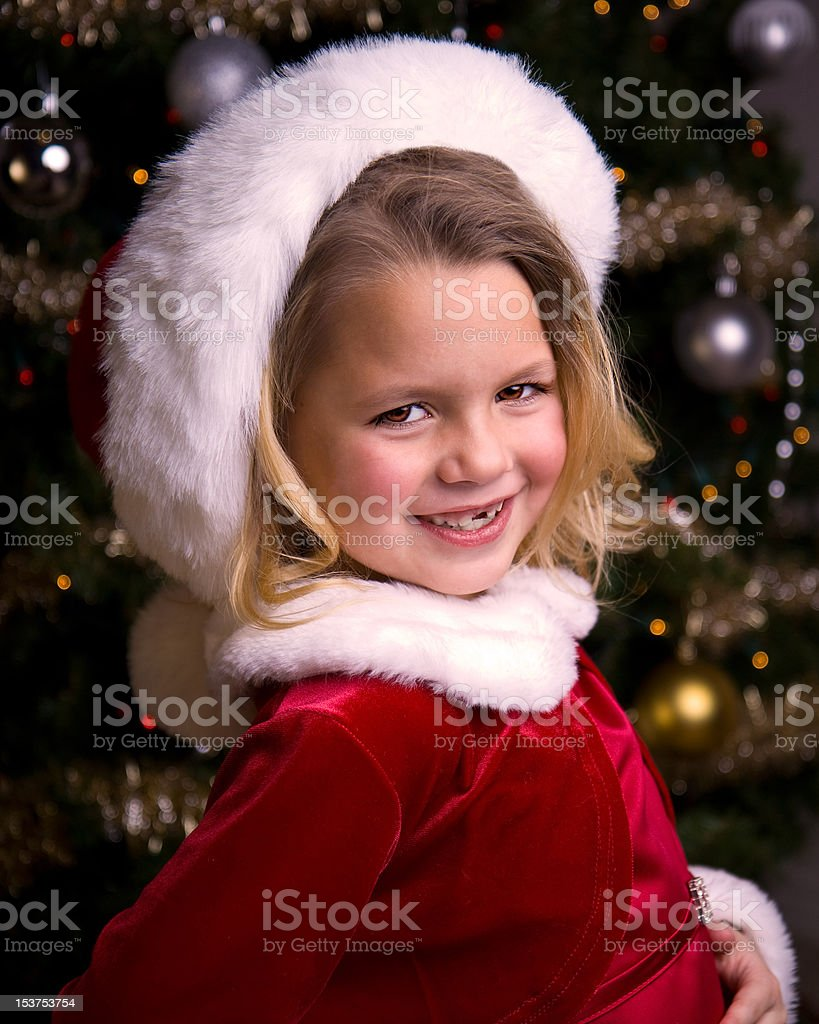 Adorable little girl in a Santa Hat royalty-free stock photo