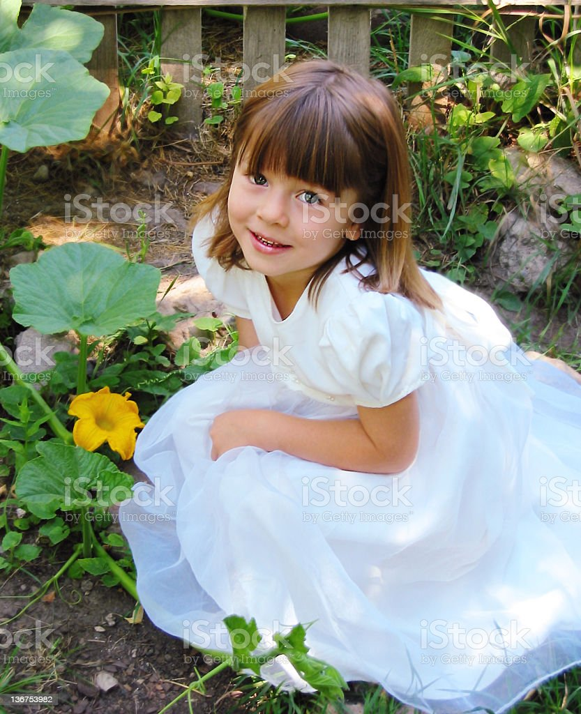 Adorable Little Girl in White Dress. royalty-free stock photo