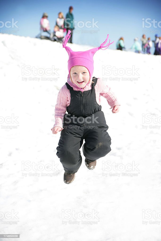 Adorable Little Girl Jumping in Snow royalty-free stock photo