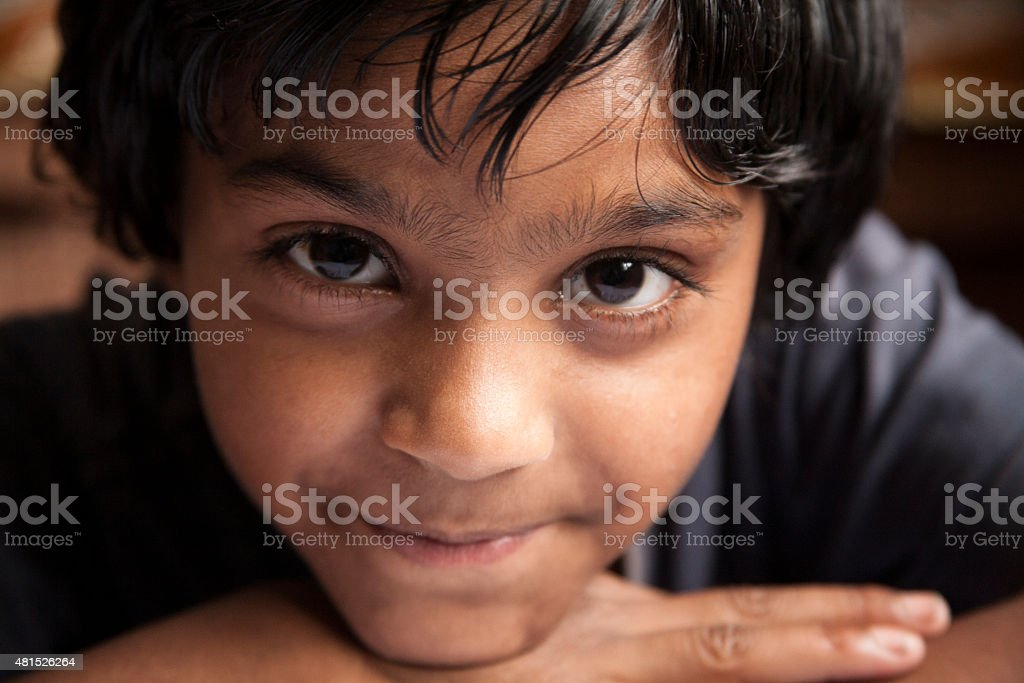 Adorable little girl living in India. Close-up, portrait. stock photo