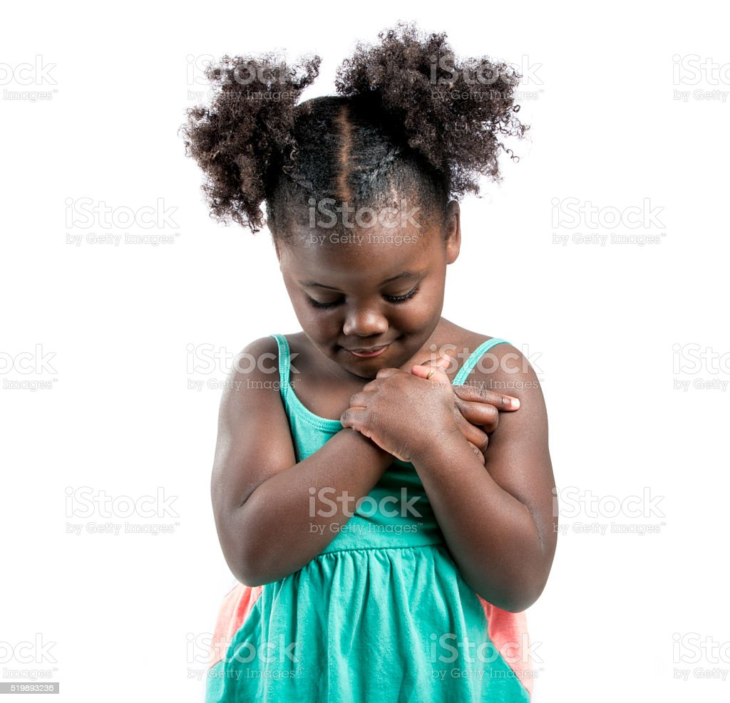 Adorable Little Girl Looking Down stock photo