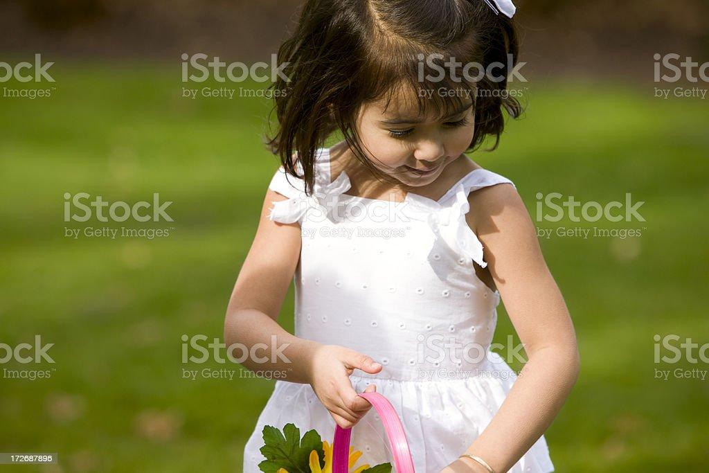 'Adorable Little Girl on Easter Egg Hunt Outside, Copy Space' stock photo