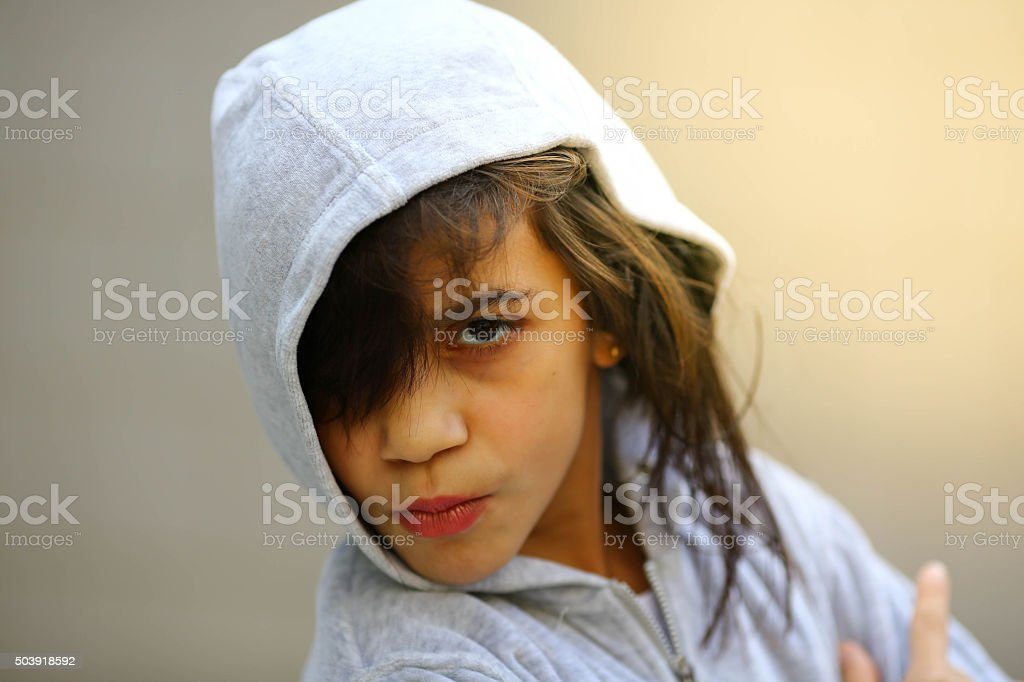 Adorable little girl portrait in hoodie stock photo