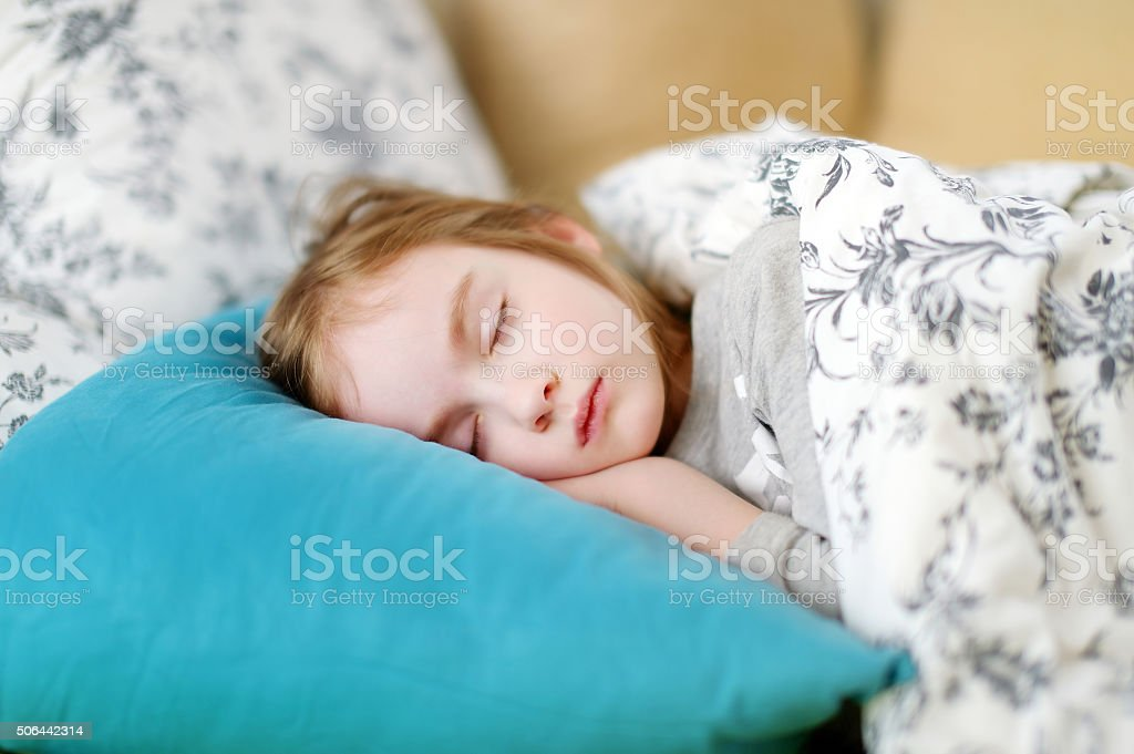 Adorable little girl sleeping stock photo