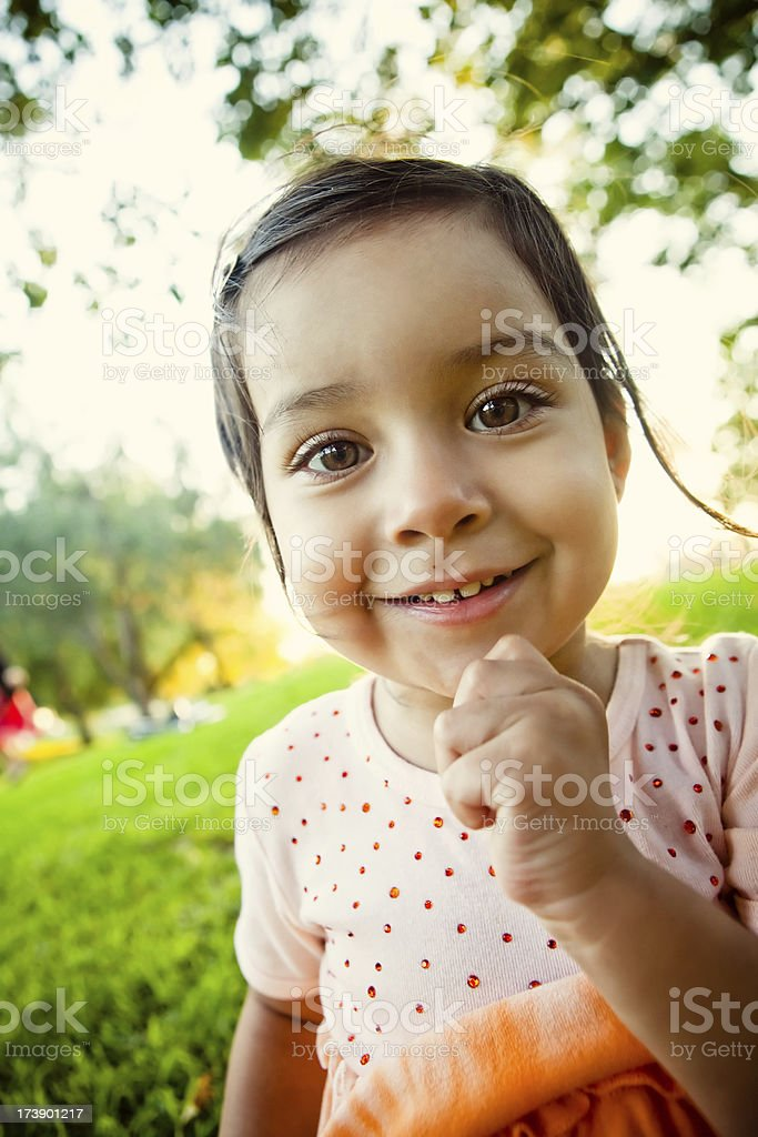 adorable little girl smiling at the park royalty-free stock photo