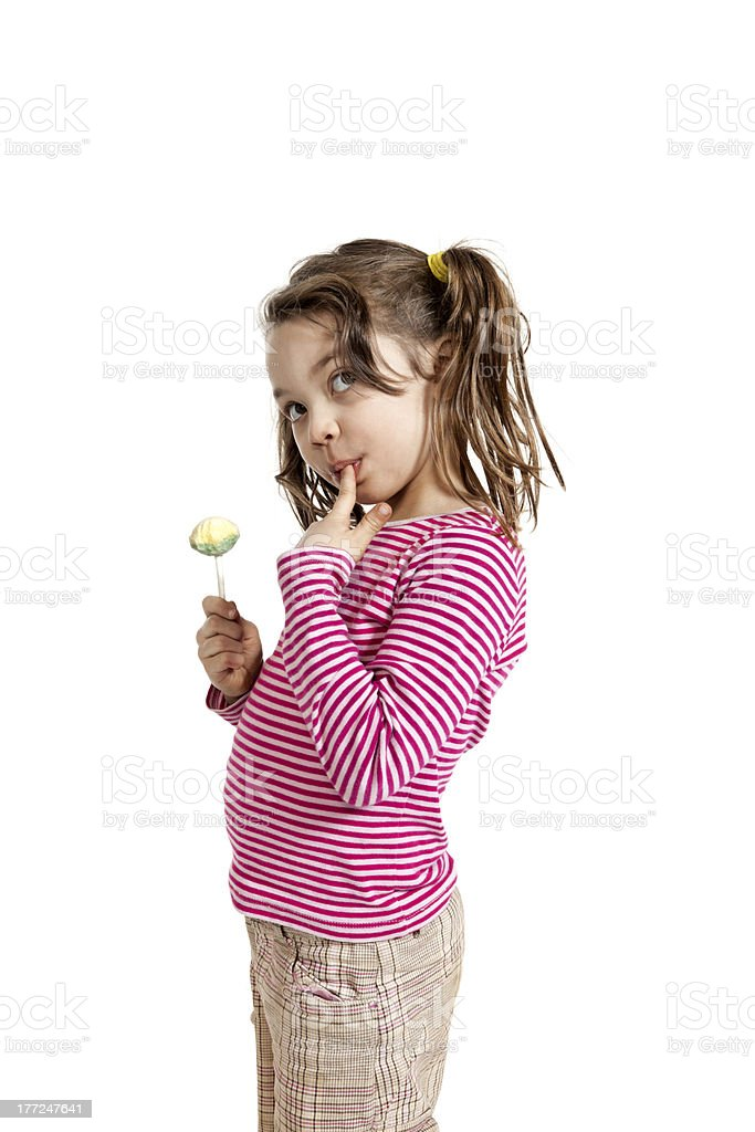 adorable little girl with a lollipop royalty-free stock photo
