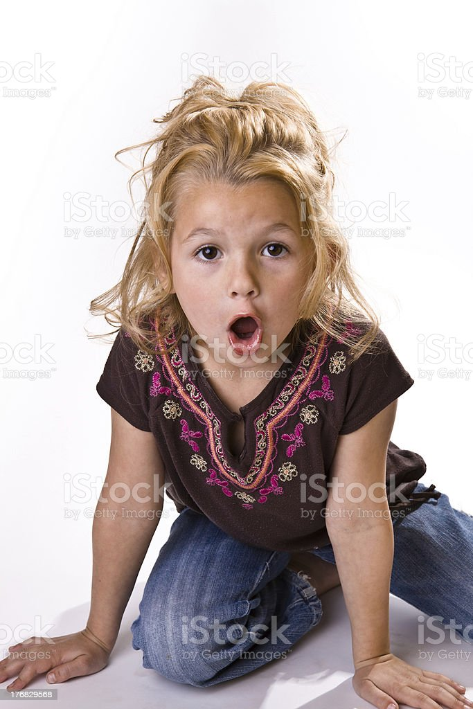 Adorable little girl with a surprised look on her face royalty-free stock photo