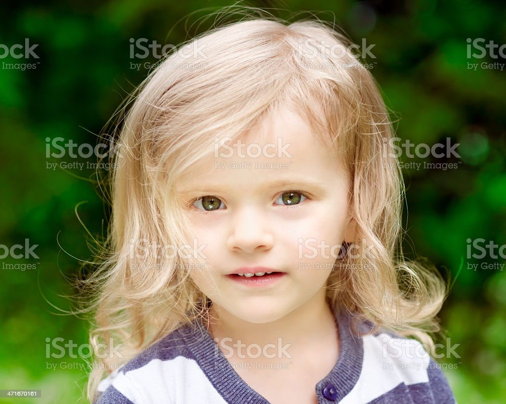 Adorable little girl with blond curly hair, closeup portrait royalty-free stock photo