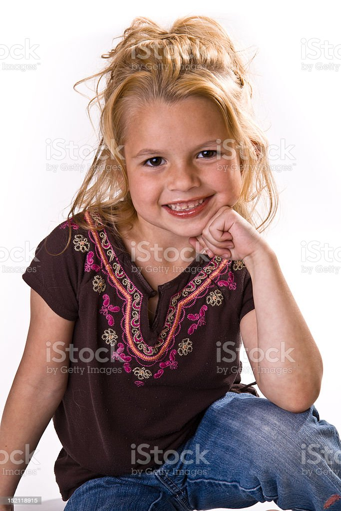 Adorable little girl with blond hair, chin on her hand. royalty-free stock photo