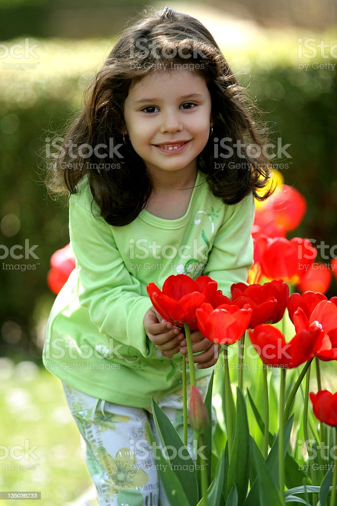 adorable little girl with flowers royalty-free stock photo