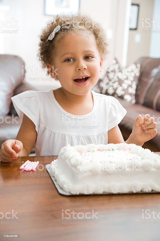 Adorable little girl with her birthday cake royalty-free stock photo