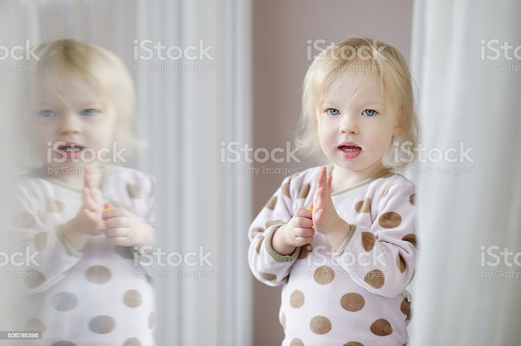 Adorable little girl with milk moustache stock photo
