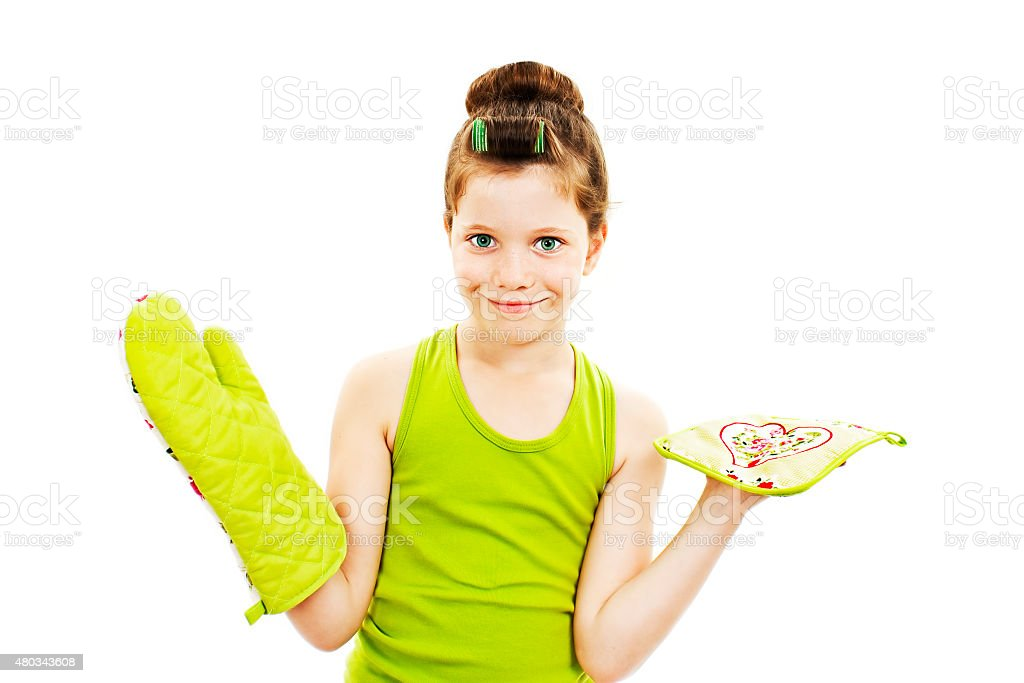 Adorable little housewife with oven mittens and dishcloth stock photo
