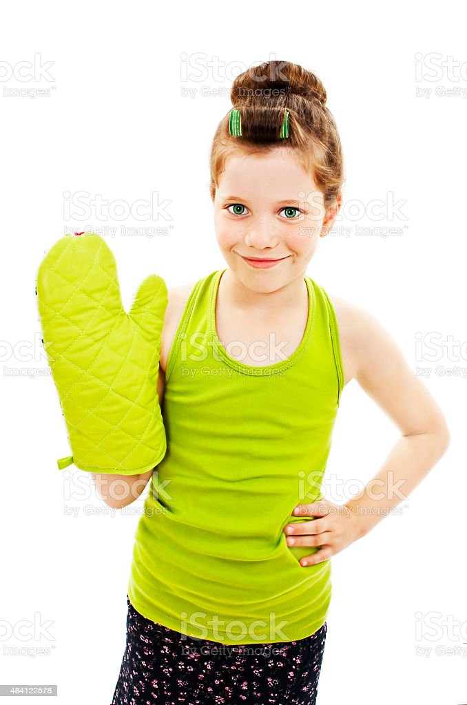 Adorable little housewife with oven mittens stock photo