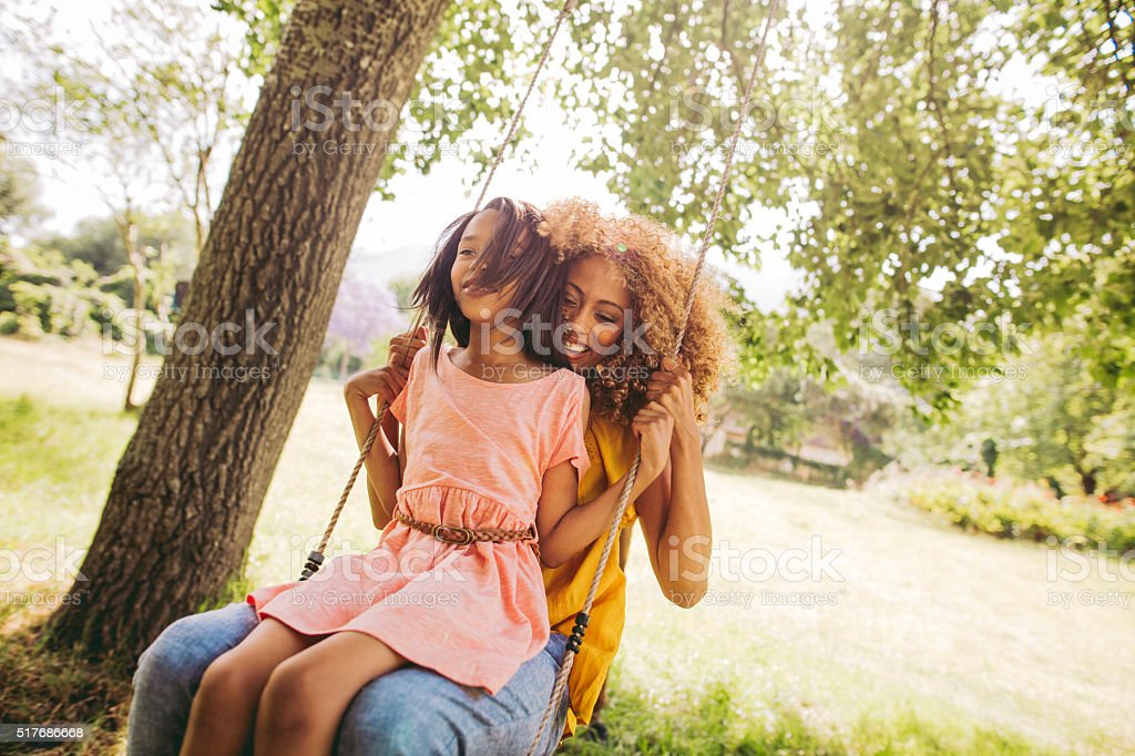 Adorable mom and daughter spends some quality time together. stock photo