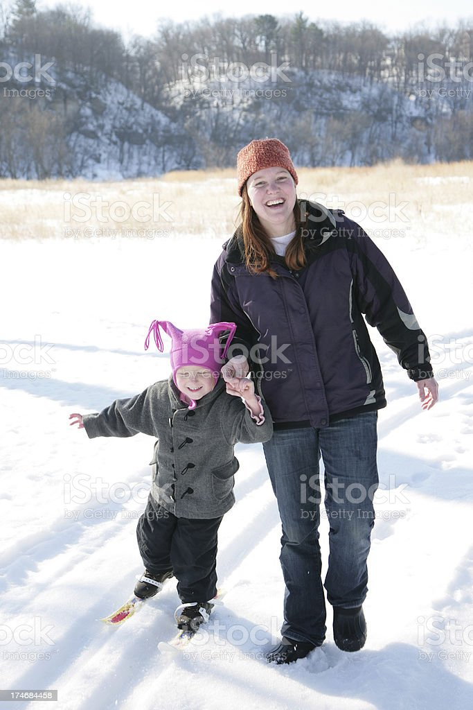 Adorable Mom Helps Daughter Cross Country Ski royalty-free stock photo