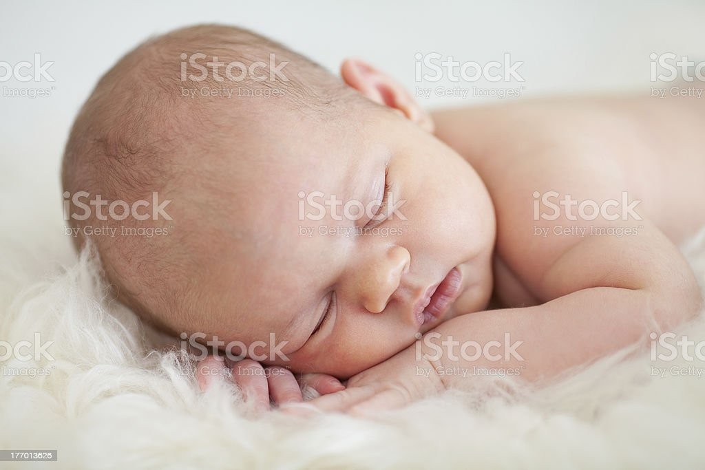 adorable newborn baby girl sleeping on her stomach royalty-free stock photo