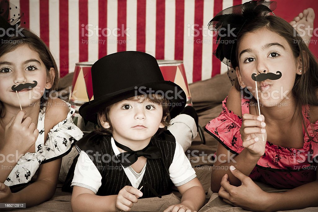 Adorable ringmaster with assistants stock photo