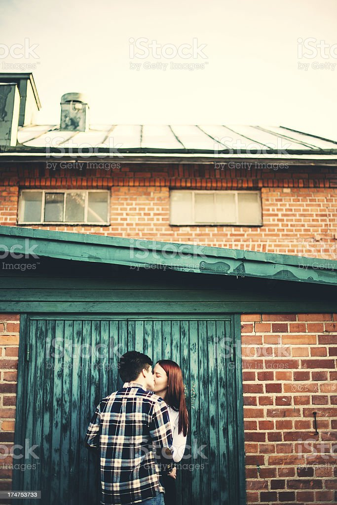 Adorable teenagers kissing royalty-free stock photo