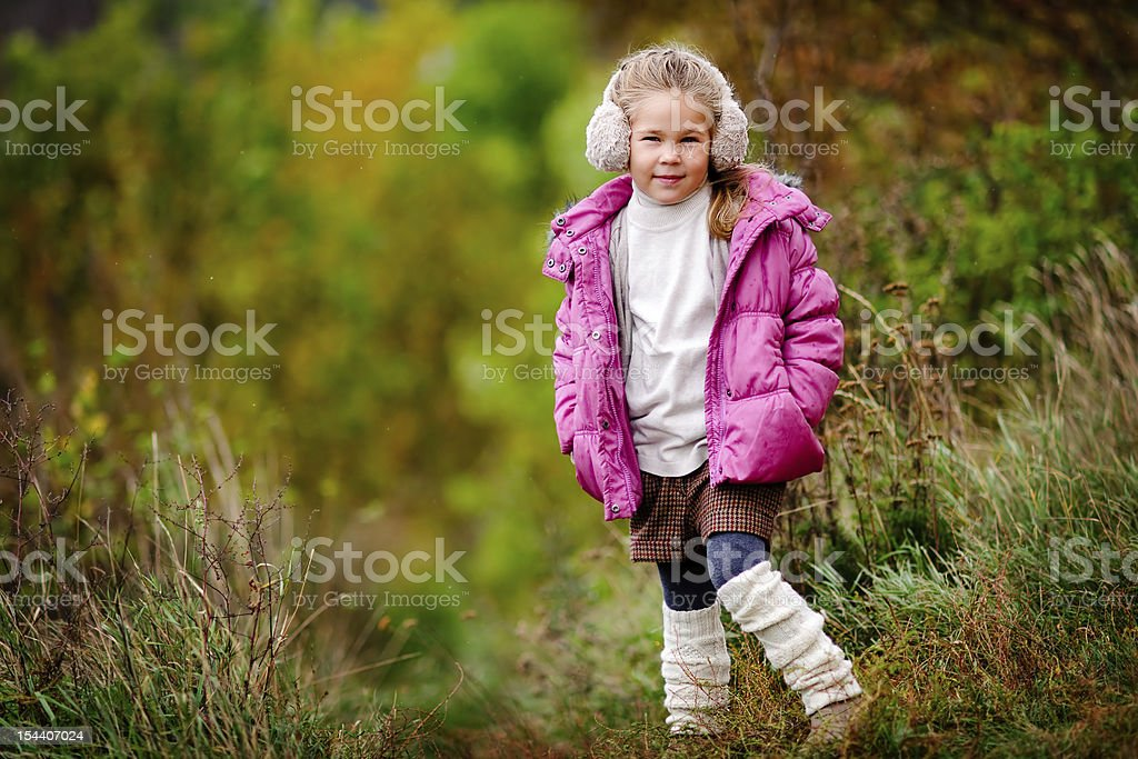 adorable toddler girl wearing fashion clothes at autumn background stock photo