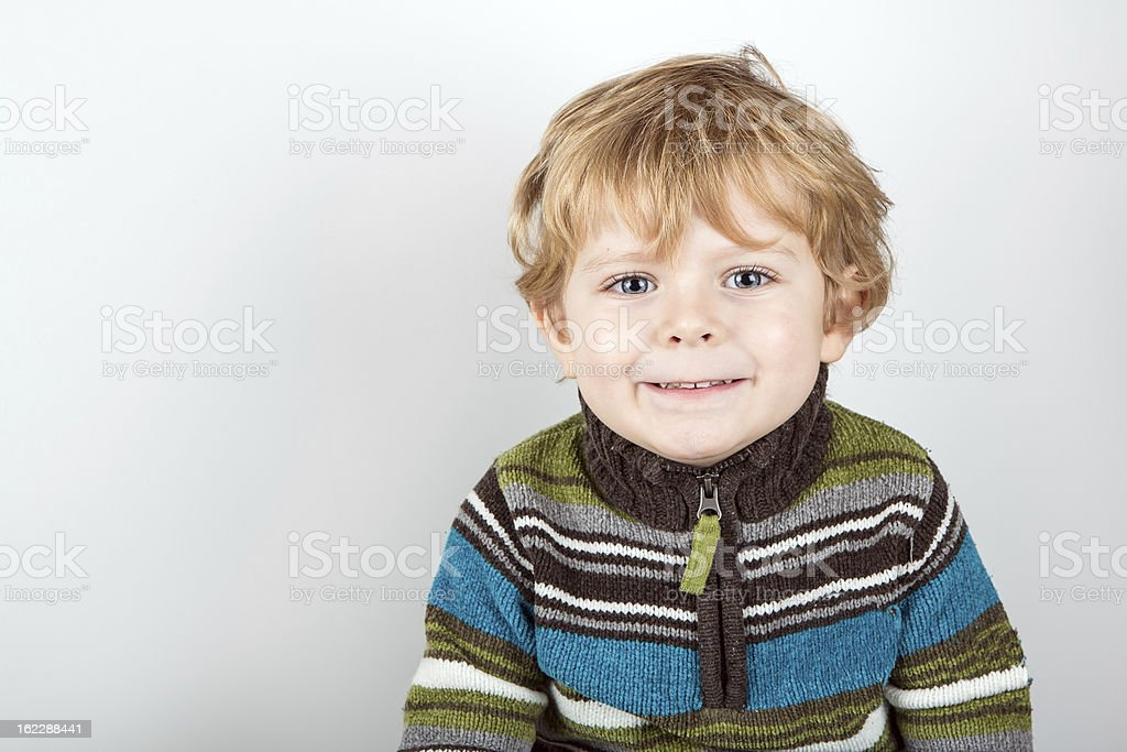 Adorable toddler with blue eyes indoor royalty-free stock photo