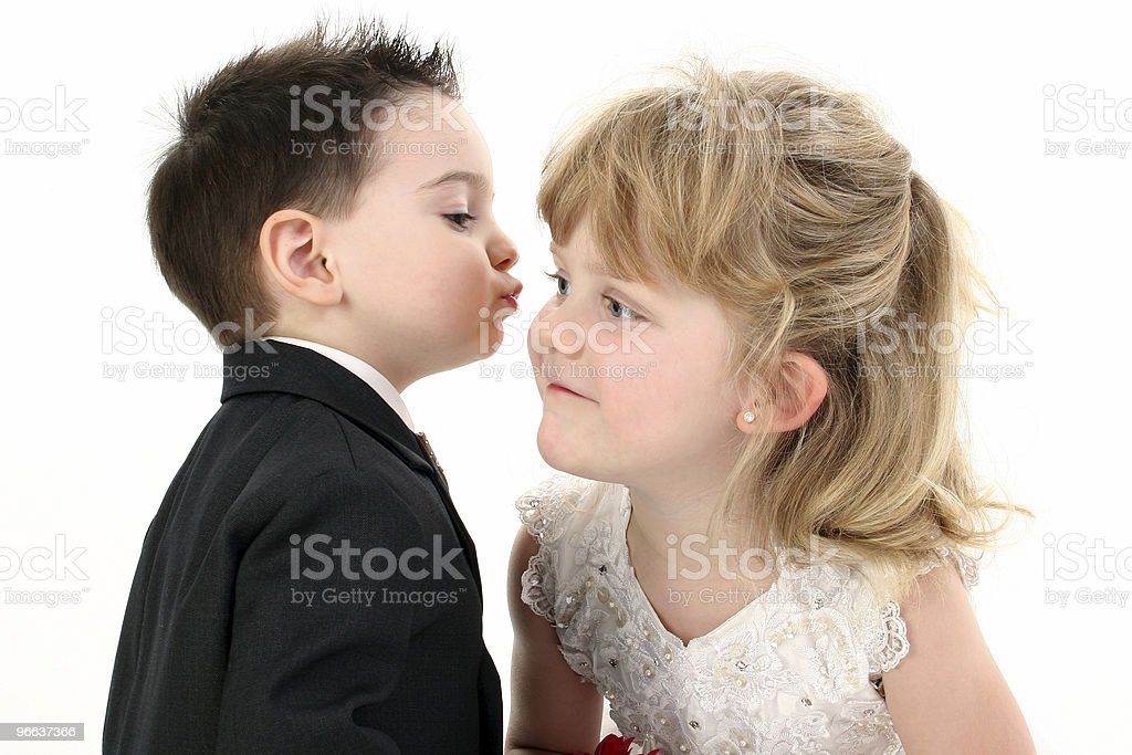 Adorable Two Year Old Boy Puckered Up To Give His Girl A Kiss royalty-free stock photo