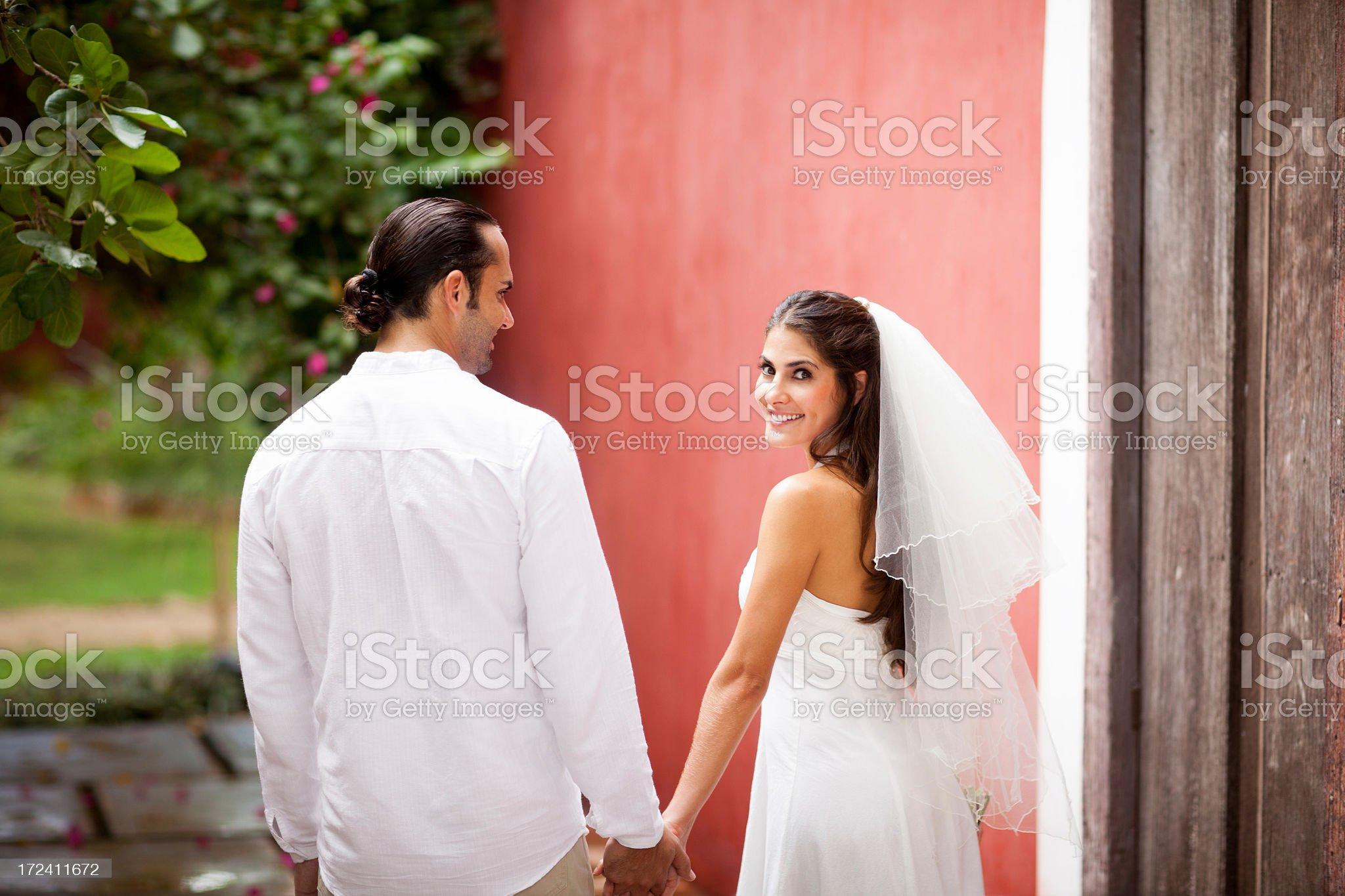 Adorable wedding couple walking royalty-free stock photo