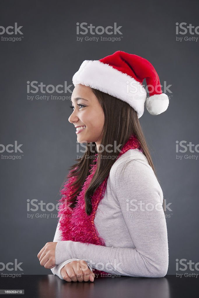 Adorable Young Asian Woman in Santa Hat and Mittens stock photo
