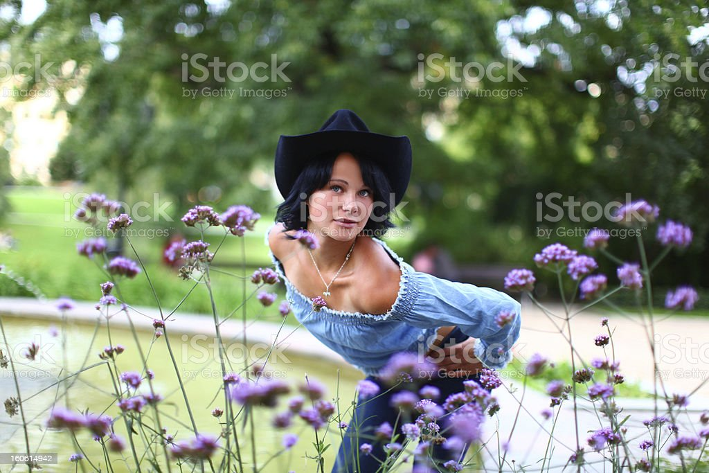 Adorable young brunette in cowboy style royalty-free stock photo