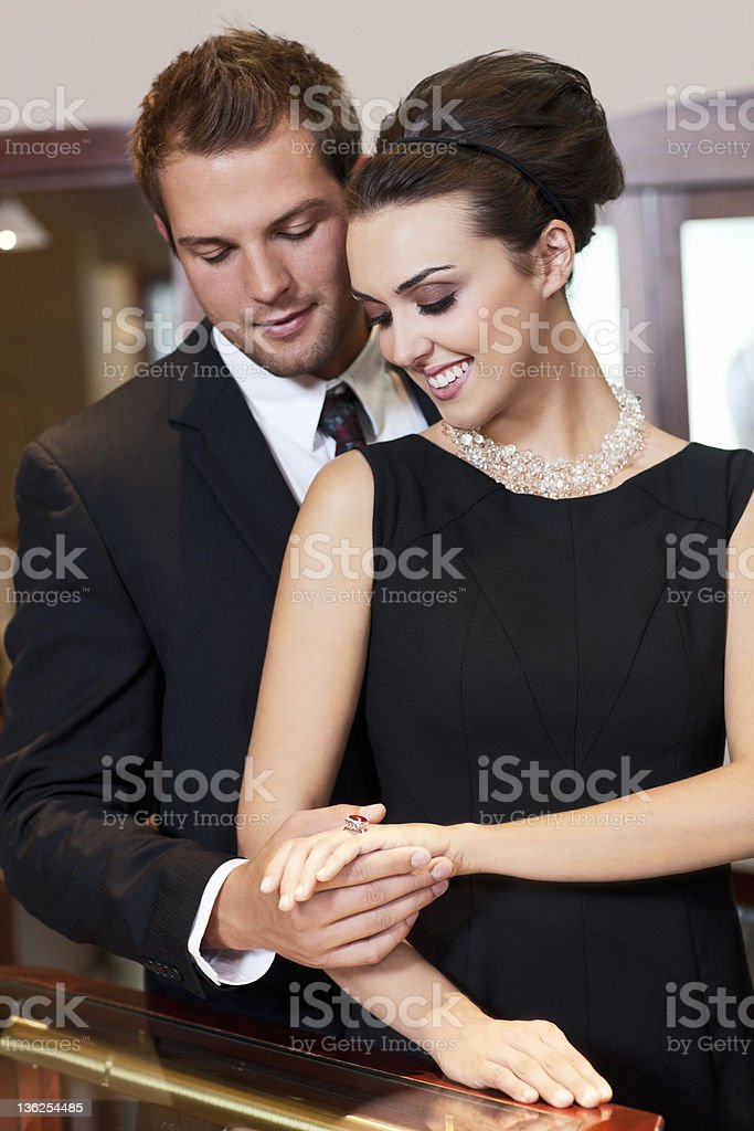 Adorable Young Couple Shopping in Jewelry Store stock photo