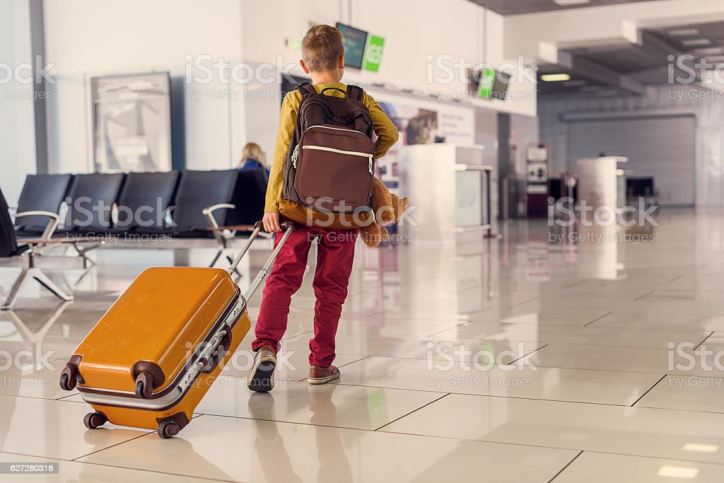 Adoralbe little boy at airport stock photo