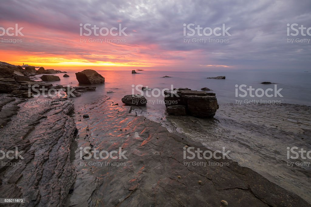 Adriatic cliff after sunset stock photo
