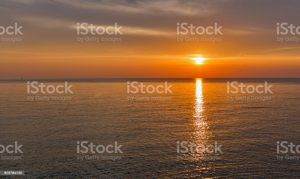Adriatic sea and red blue sky at sunset in Croatia stock photo