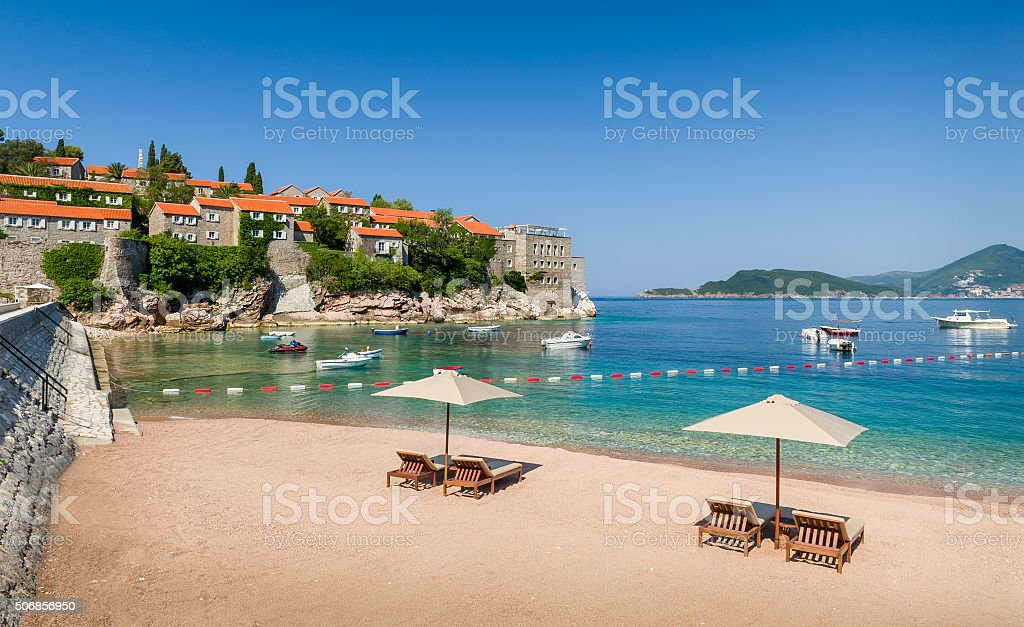 Adriatic sea luxury sand beach with chaise-longue chairs and stock photo