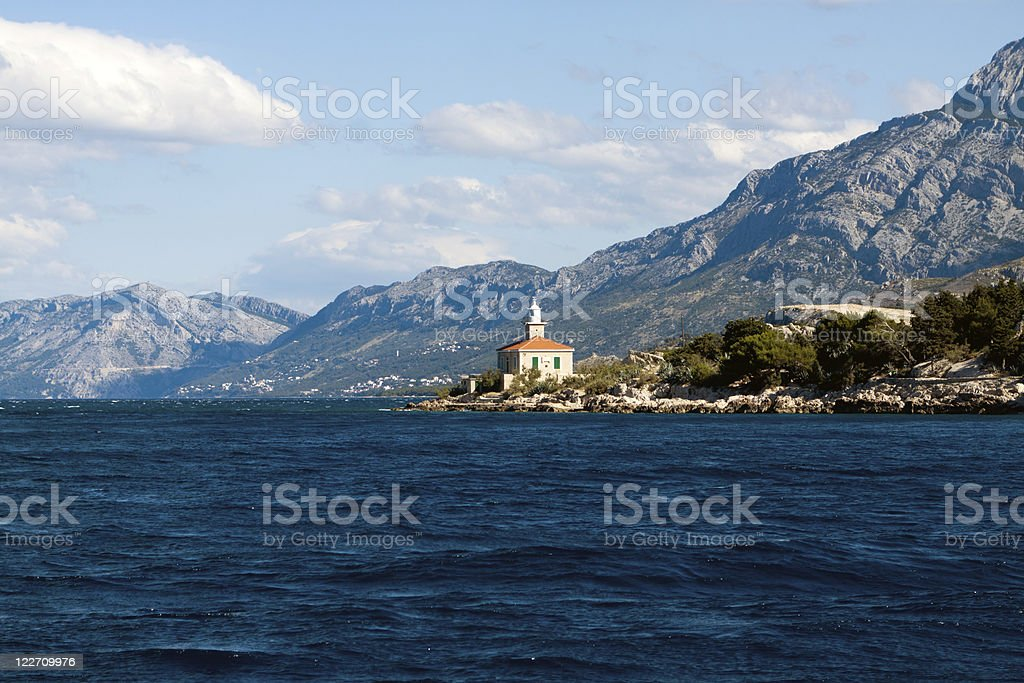 Adriatic Sea, mountains and a lighthouse stock photo