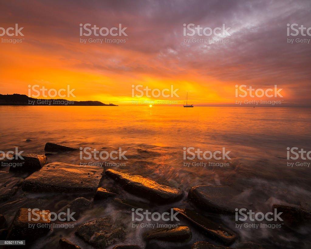 Adriatycki klif po zachodzie słońca stock photo