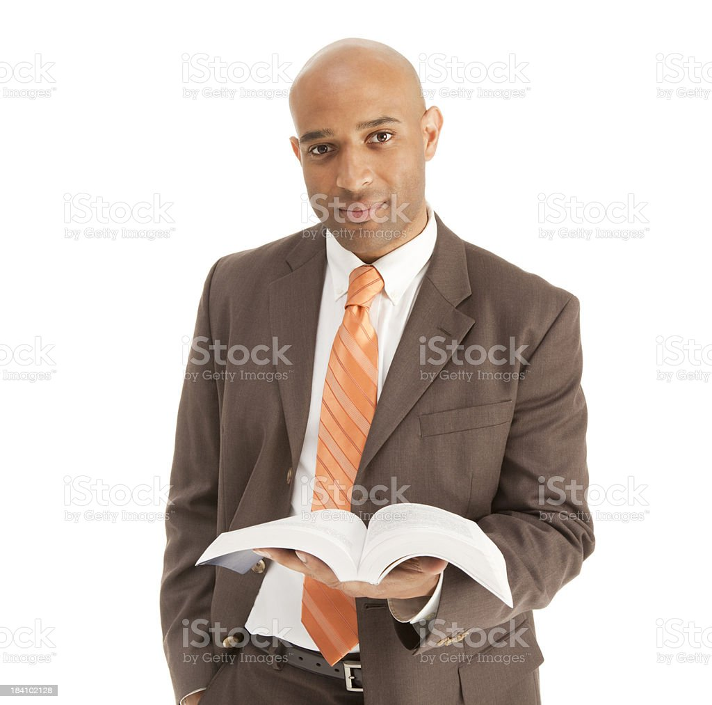 Adult African American male Minister Preacher Priest holding the Bible royalty-free stock photo