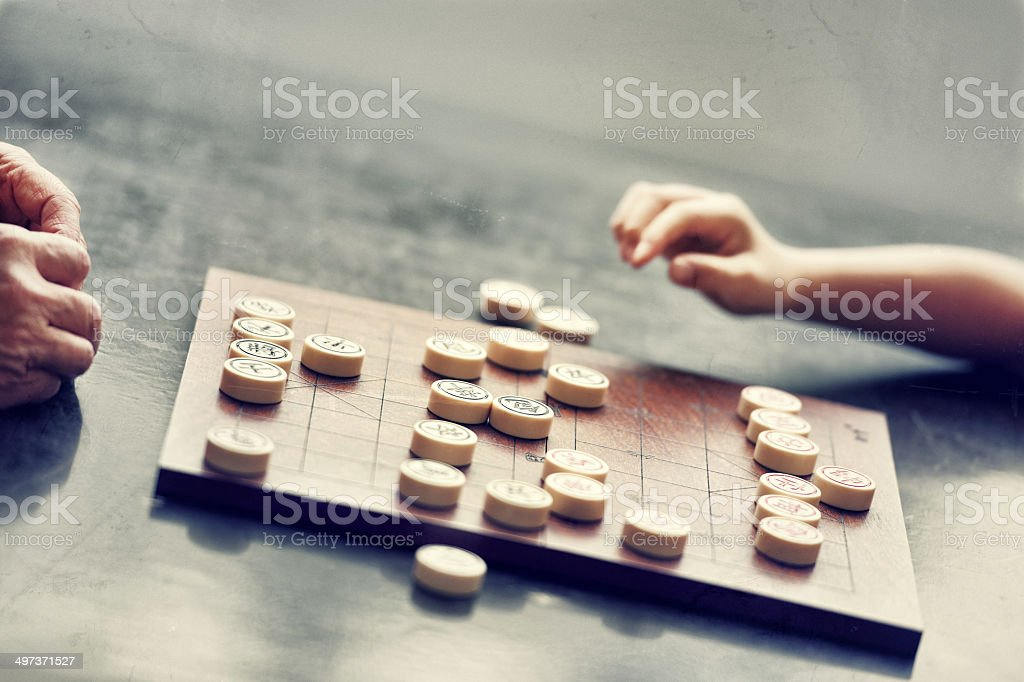 Adult and Child playing Xiangqi (chinese chess) stock photo
