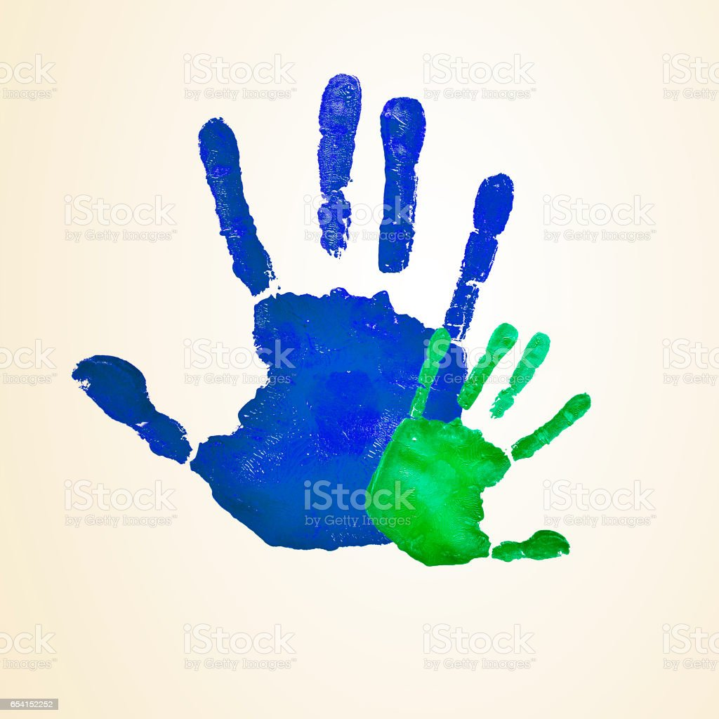 adult and infant handprints stock photo