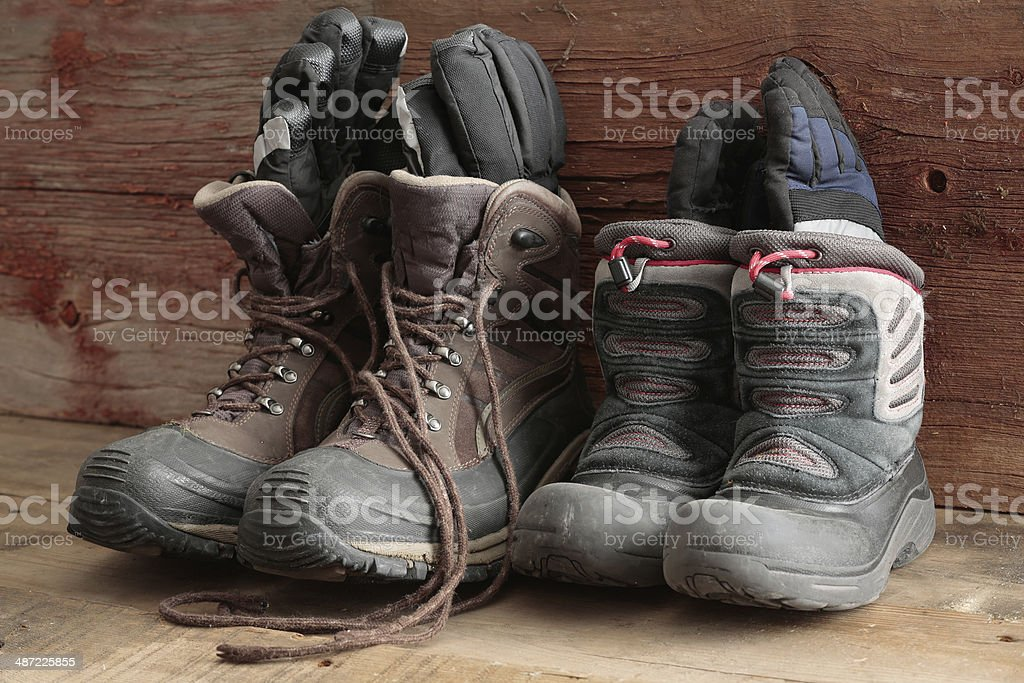 Adult and kids old winter snow boots stock photo