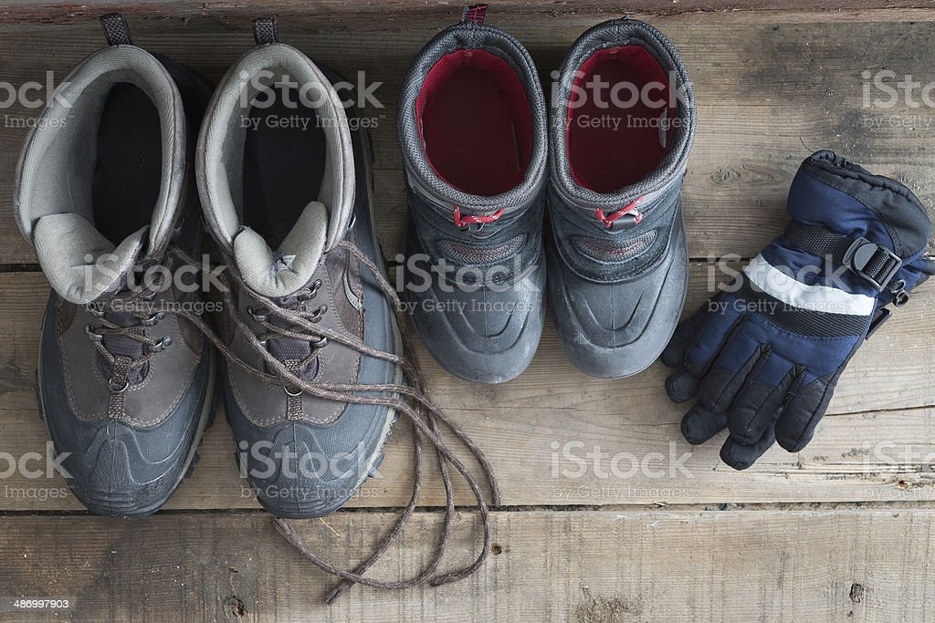 Adult and kids snow boots with gloves stock photo