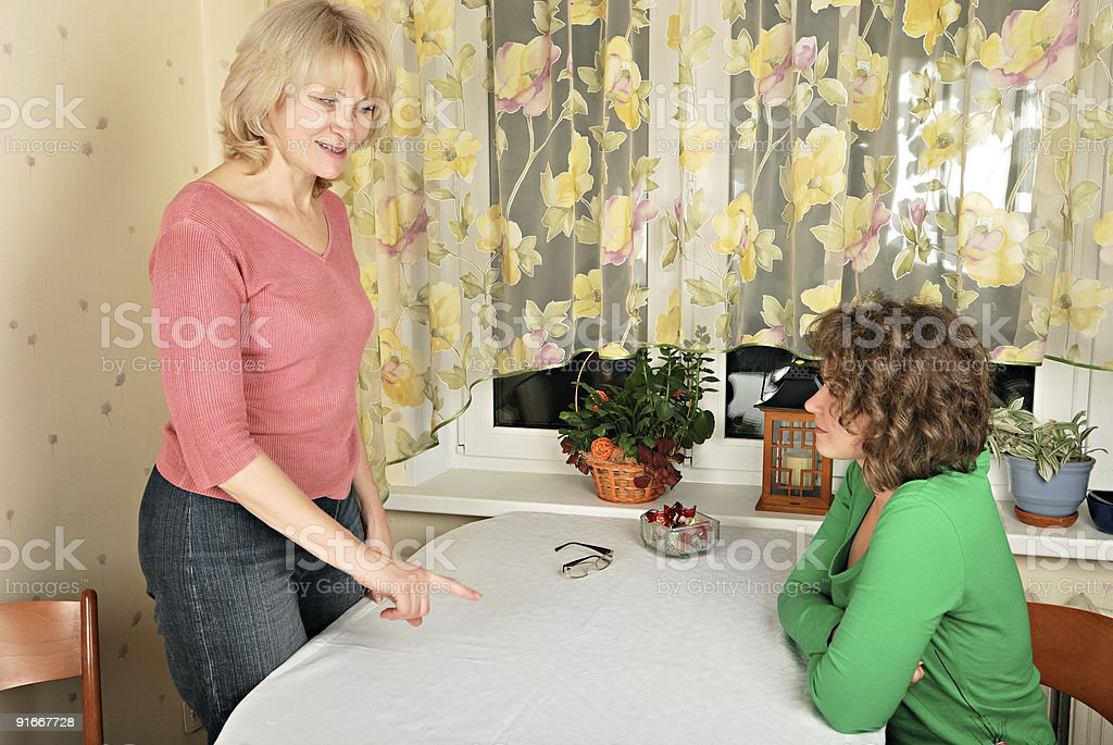 Adult and young women: jocular punishment stock photo