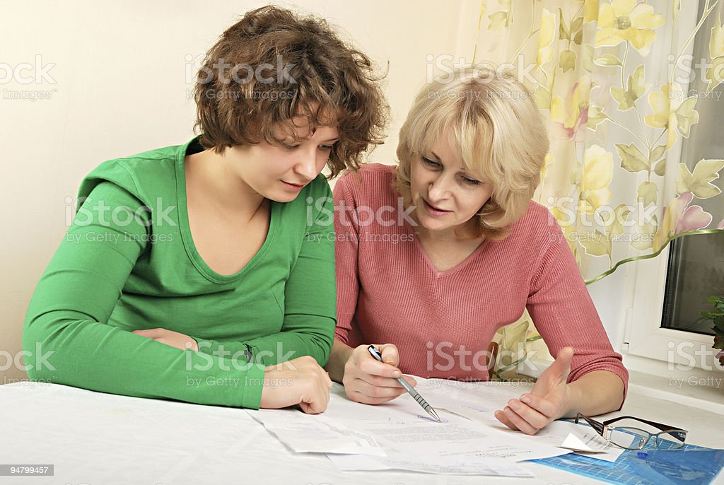 Adult and young women with documents royalty-free stock photo