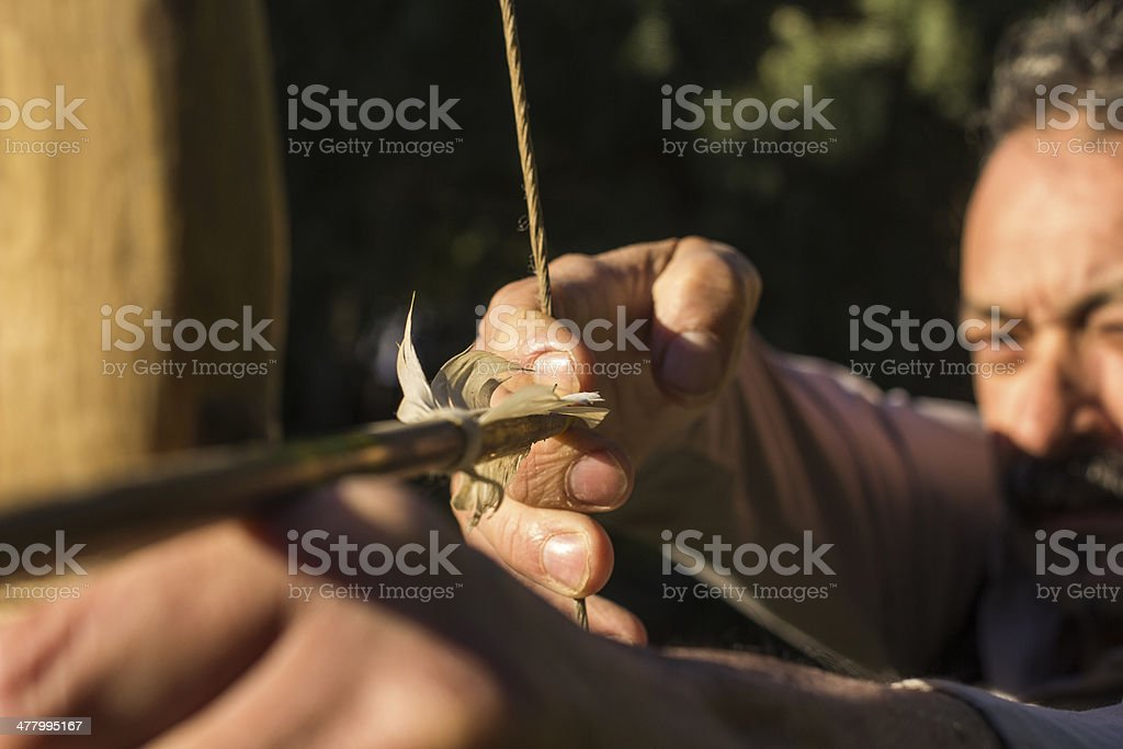 Adult archer about to shoot an arrow royalty-free stock photo