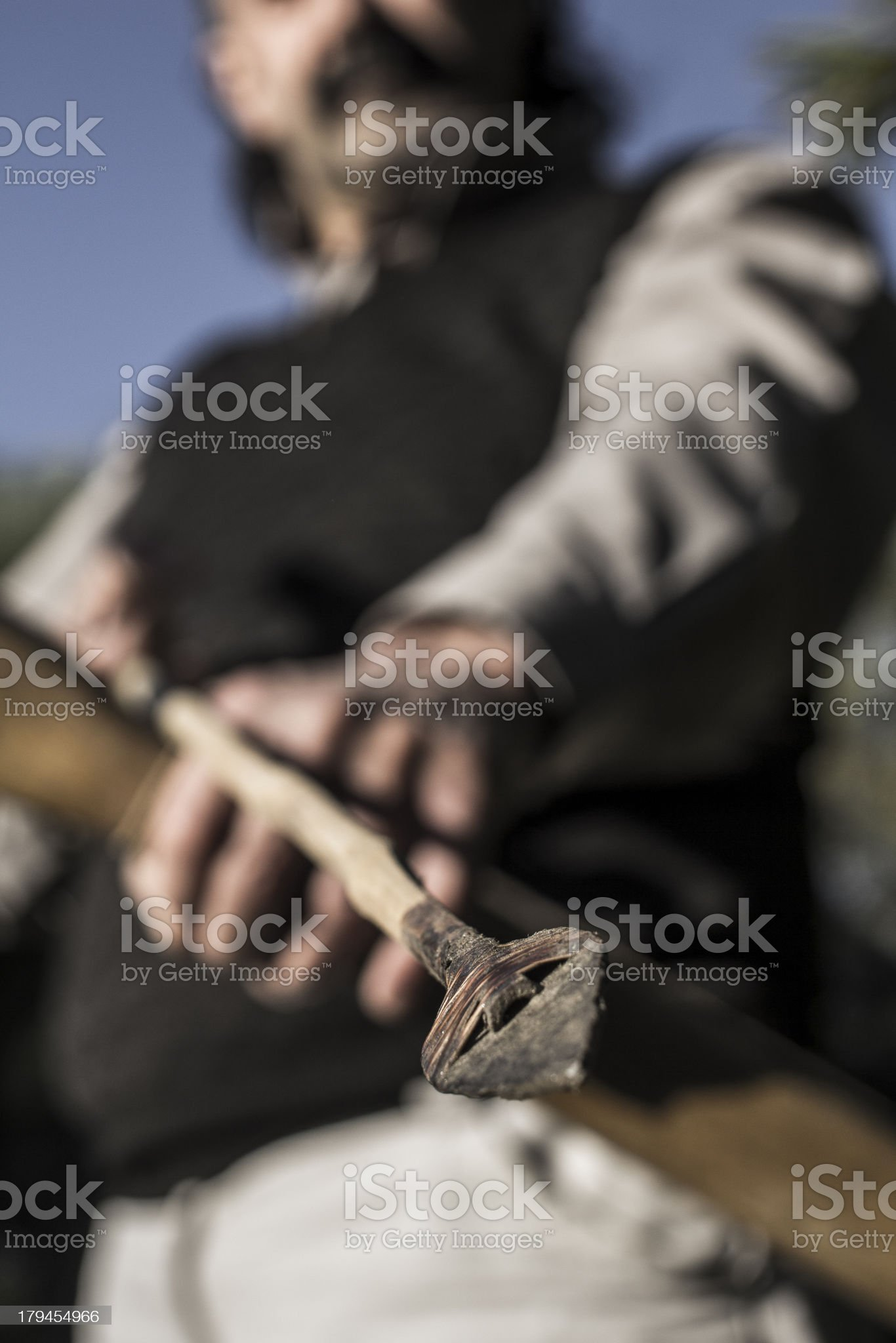 Adult Archer with Arrow and Bow in Close-Up royalty-free stock photo