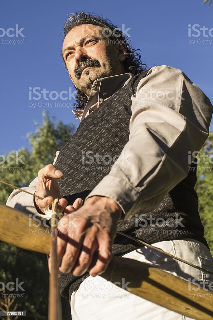 Adult archer with Arrow and Bow Outdoors royalty-free stock photo