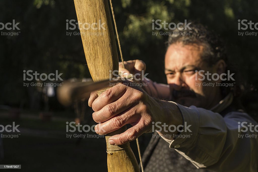 Adult Archer with Arrow and Bow Shooting at Target royalty-free stock photo