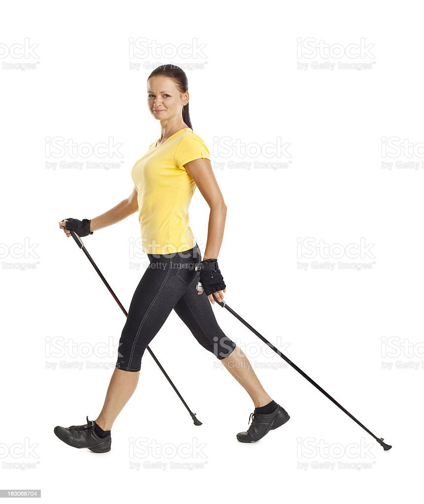 adult attractive woman exercises Nordic Walking royalty-free stock photo